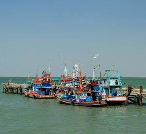 Image cropthai fishing boatsdreamstimexs67530406 thumb 2x